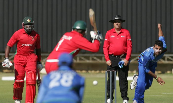 Afghanistan's Dawlat Zadran bowls to Zimbabwe captain Brendan Taylor as Hamilton Masakadza watches during the third cricket match of a four match ODI series between Afghanistan and hosts Zimbabwe at the Queens Sports Club in Bulawayo on July 22, 2014. (AFP/Getty Images)