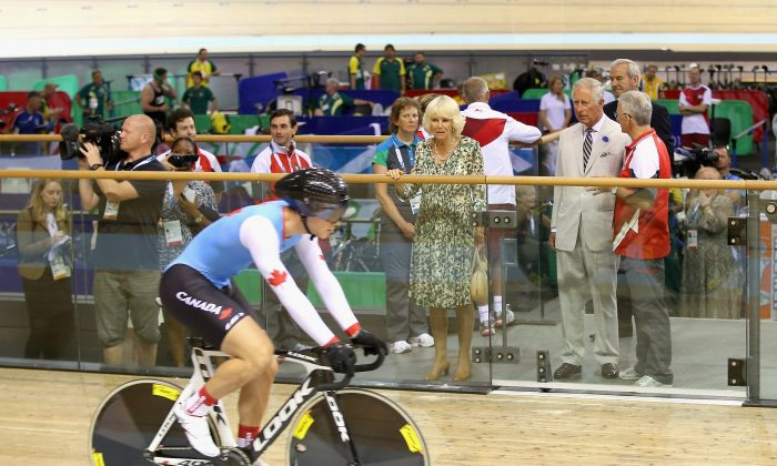 Prince Charles, Prince of Wales and Camilla, Duchess of Cornwall watch a Canadian cyclist in the velodrome during a visit to the Emirates Arena and Chris Hoy Velodrome ahead of the start of the Commonwealth games on July 23, 2014 in Glasgow, Scotland. (Chris Jackson/Getty Images)