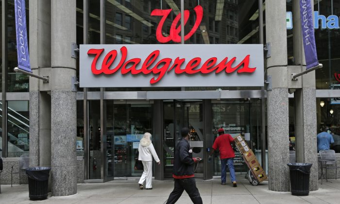 "Walgreen Co.—which bills itself as ""America's premier pharmacy""— is among many companies considering combining operations with foreign businesses to trim their tax bills. These deals, called inversions, have raised concerns among some U.S. lawmakers over the potential for lost tax revenue. (AP Photo/Charles Krupa)"
