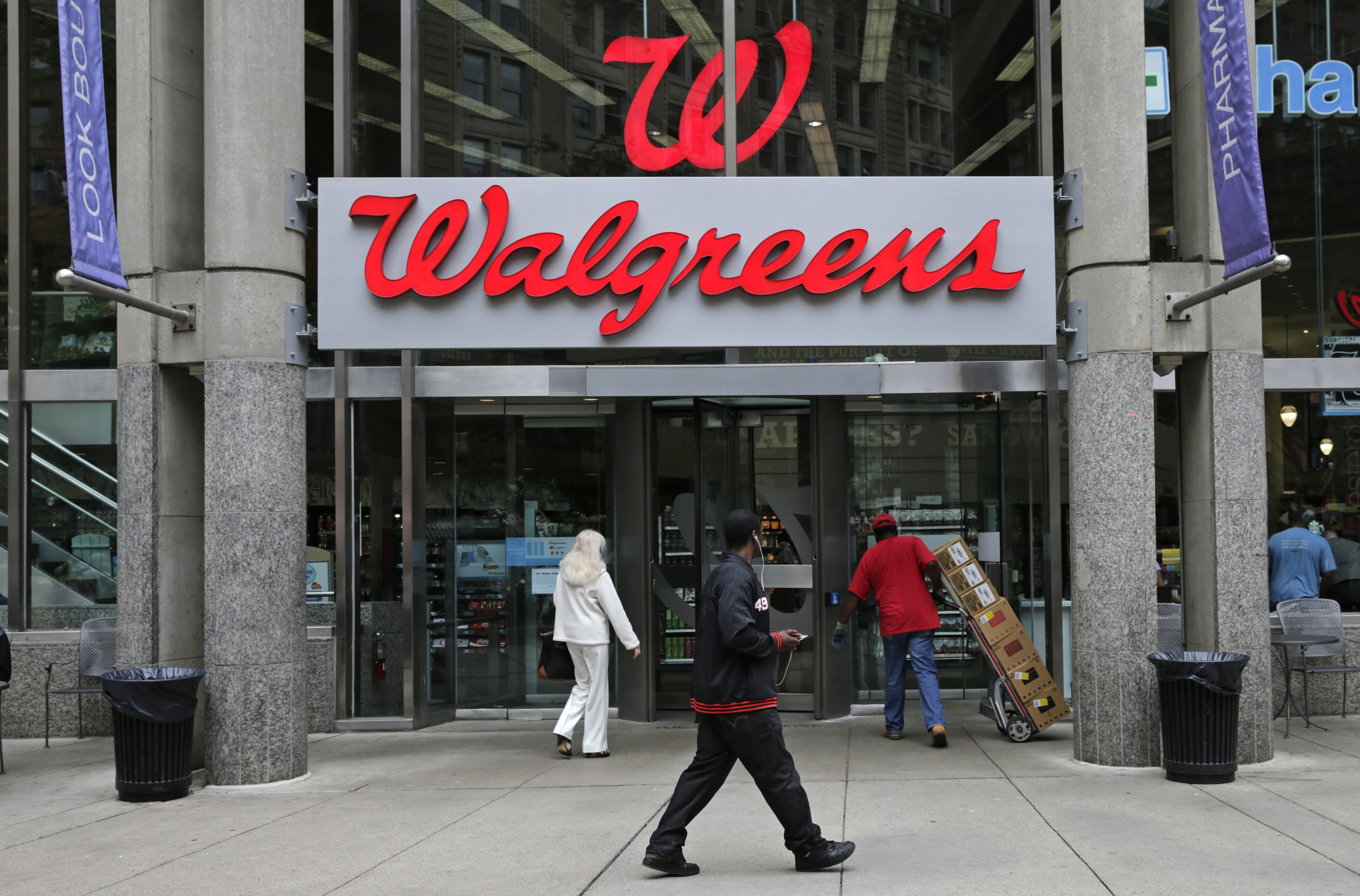 """Walgreen Co.—which bills itself as """"America's premier pharmacy""""— is among many companies considering combining operations with foreign businesses to trim their tax bills. These deals, called inversions, have raised concerns among some U.S. lawmakers over the potential for lost tax revenue. (AP Photo/Charles Krupa)"""