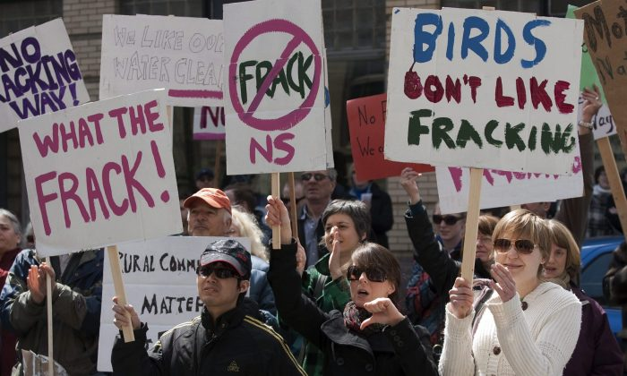 Protesters gather outside the Nova Scotia legislature in Halifax to show their opposition to the use of hydraulic fracturing on April 22, 2011. Environmentalists and legal experts are criticizing the federal government's decision to leave toxic fracking chemicals off a list of pollutants going into Canada's air, land, and water. (The Canadian Press/Andrew Vaughan)