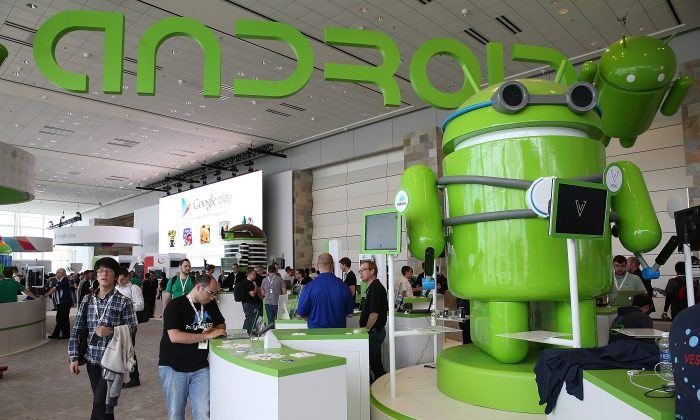 Attendees visit the Android booth during the Google I/O developers conference at the Moscone Center on May 15, 2013 in San Francisco, California. (Photo by Justin Sullivan/Getty Images)