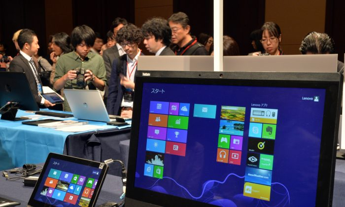 US software giant Microsoft pre-installed Windows 8.1 personal computers and tablets are displayed at a Windows 8.1 launching event in Tokyo on Oct. 18, 2013. (Yoshikazu Tsuno/AFP/Getty Images)