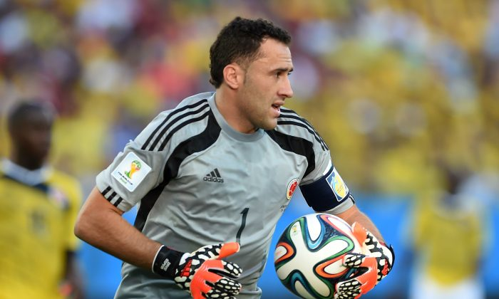 Colombia's goalkeeper David Ospina clears the ball during a Group C football match between Japan and Colombia at the Pantanal Arena in Cuiaba during the 2014 FIFA World Cup on June 24, 2014. (TOSHIFUMI KITAMURA/AFP/Getty Images)