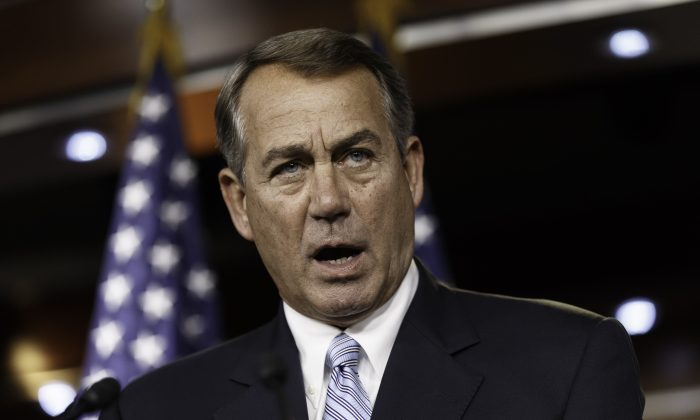 House Speaker John Boehner of Ohio arrives for a news conference on Capitol Hill in Washington, Wednesday, June 25, 2014. Boehner said Wednesday the Republican-controlled House will file an election-year lawsuit accusing President Barack Obama of failing to carry out the laws passed by Congress. (AP Photo/J. Scott Applewhite)