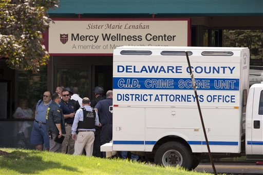 Investigators work the scene of a shooting Thursday, July 24, 2014, at Mercy Fitzgerald Hospital in Darby, Pa. A shooting at the suburban Philadelphia hospital campus has killed one worker and injured two other people. Prosecutor Jack Whelan says one of the injured is the gunman. (AP Photo)