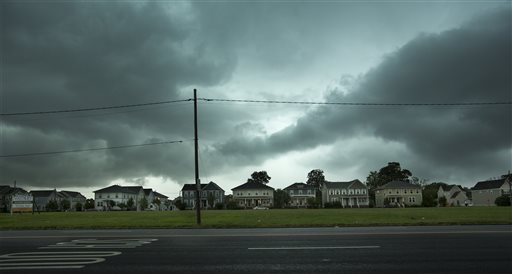 Storm clouds approach Portsmouth, Va., Thursday morning, July 24, 2014, as severe storms passed through the area. (AP Photo/The Virginian-Pilot, Bill Tiernan)