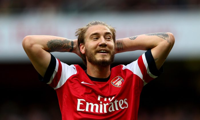 Nicklas Bendtner of Arsenal reacts during the Barclays Premier League match between Arsenal and Norwich City at Emirates Stadium on October 19, 2013 in London, England. (Photo by Paul Gilham/Getty Images)