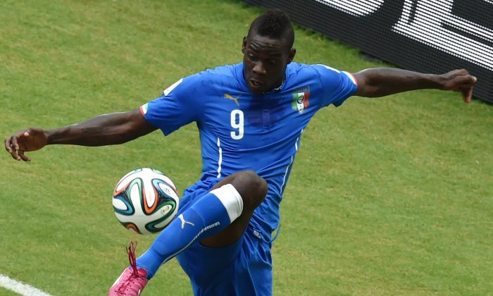 Italy's forward Mario Balotelli controls the ball during a Group D football match between Italy and Uruguay at the Dunas Arena in Natal during the 2014 FIFA World Cup on June 24, 2014. (YASUYOSHI CHIBA/AFP/Getty Images)