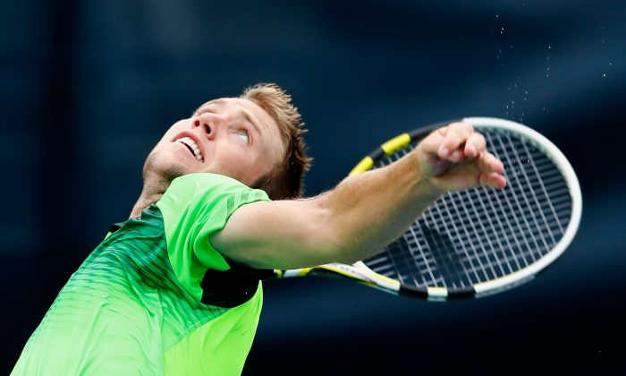 Jack Sock serves to Michael Venus of New Zealand during the BB&T Atlanta Open at Atlantic Station on July 23, 2014 in Atlanta, Georgia. (Kevin C. Cox/Getty Images)
