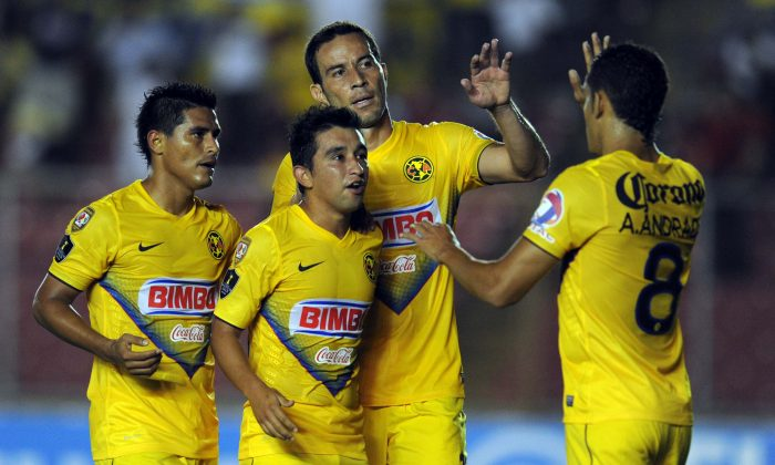 Christian Bermudez (C) of Mexico's Club America celebrate with teammate after scoring against Sporting San Miguelito of Panama, during their CONCACAF Champions League match, at the Rommel Fernandez stadium in Panama City on August 7, 2013. (RODRIGO ARANGUA/AFP/Getty Images)