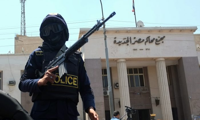 Egyptian police special forces secure the area outside a courthouse in the Cairo district of Heliopolis after a makeshift bomb that was placed under a car exploded wounding a woman, on June 25, 2014. (Khaled Desouki/AFP/Getty Images)