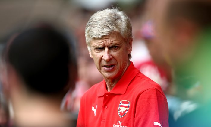 Arsenal manager Arsene Wenger looks on during the pre season friendly match between Borehamwood and Arsenal at Meadow Park on July 19, 2014 in Borehamwood, England. (Photo by Jordan Mansfield/Getty Images)