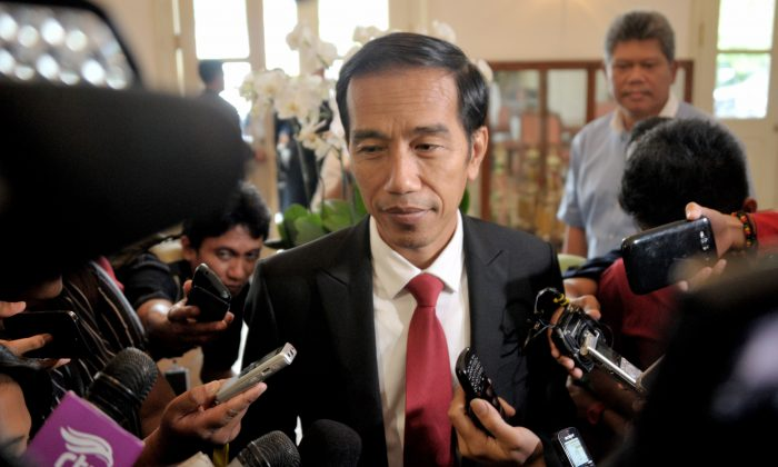 Indonesian president elect Joko Widodo (C) answers questions from the media in Jakarta on July 23, 2014 as Widodo returns to work after the General Elections Commission declared him the winner of the presidential elections. The ex-general who lost Indonesia's presidential election to Joko Widodo will challenge the result in court, his campaign team said, a move that could spell weeks of uncertainty for the country. (Bay Ismoyo/AFP/Getty Images)