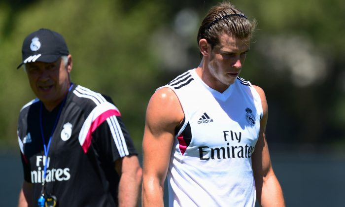 Real Madrid coach Carlo Ancelotti watches as Gareth Bales walks by during a training session at UCLA in Los Angeles, California on July 24, 2014 ahead of Real Madrid's opening Guiness International Champions Cup match against Inter Milan in Berkeley, California, on July 26. (FREDERIC J. BROWN/AFP/Getty Images)