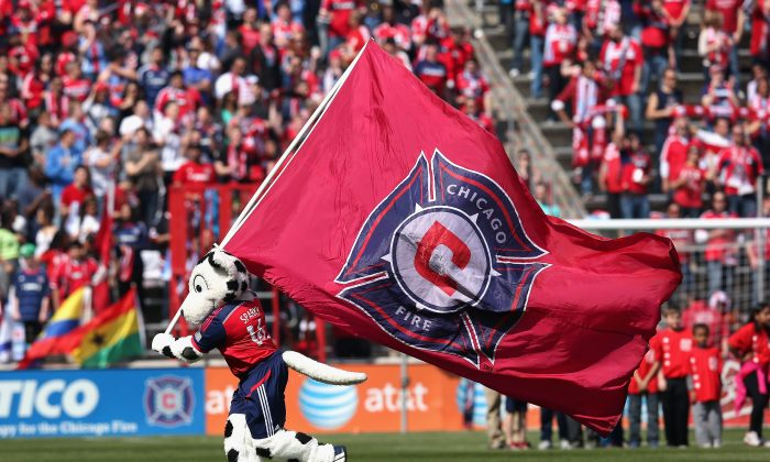 Sparky, the mascot for the Chicago Fire, runs with a flag before an MLS match between the Fire and the New England Revolution at Toyota Park on April19, 2014 in Bridgeview, Illinois. The Fire and the Revolution tied 1-1. (Photo by Jonathan Daniel/Getty Images)