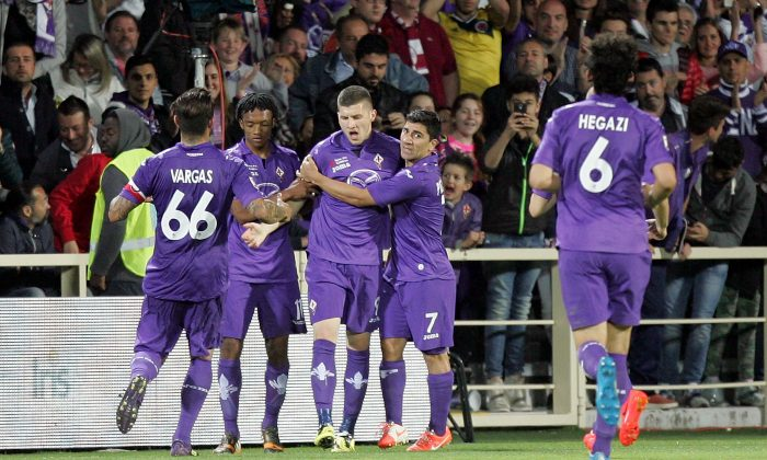 Ante Rebic #9 (C) of ACF Fiorentina celebrates after scoring a goal during the Serie A match between ACF Fiorentina and Torino FC at Stadio Artemio Franchi on May 18, 2014 in Florence, Italy. (Photo by Gabriele Maltinti/Getty Images)