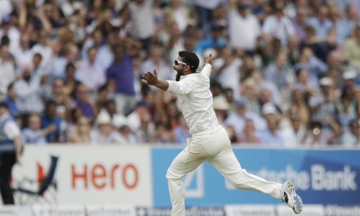 India's Ravindra Jadeja celebrates after running out England's James Anderson to win the test match on the fifth day of the second cricket test match between England and India at Lord's cricket ground in London, Monday, July 21, 2014.  India won the match by 95 runs.  The International Cricket Commission (ICC) has set next Tuesday as the date for a disciplinary hearing against James Anderson for shoving India's Ravindra Jadeja during the first test.  (AP Photo/Matt Dunham)