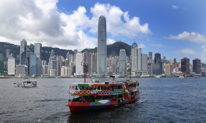 The Star Ferry crosses Hong Kong Harbor on May 31, 2013. Recent political changes are causing many Hong Kongers to emigrate from this city to other countries. (David Rogers/Getty Images)