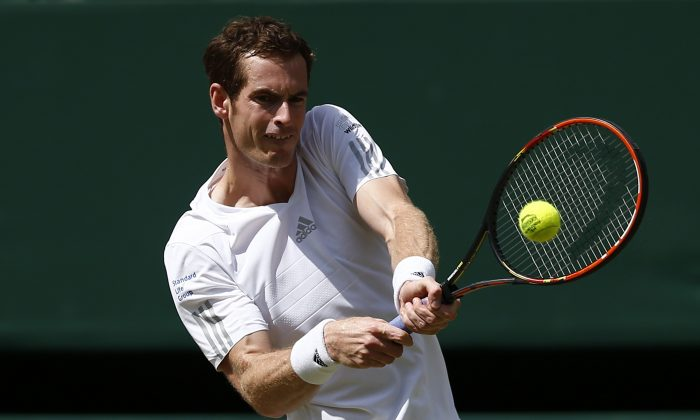 Britain's Andy Murray returns to Bulgaria's Grigor Dimitrov during their men's singles quarter-final match on day nine of the 2014 Wimbledon Championships at The All England Tennis Club in Wimbledon, southwest London, on July 2, 2014. (Andrew Cowie/AFP/Getty Images)