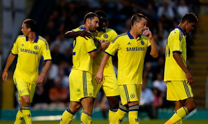 Branislav Ivanovic of Chelsea celebrates with team mates after scoring a goal duing the pre season friendly match between Wycombe Wanderers and Chelsea at Adams Park on July 16, 2014 in High Wycombe, England. (Photo by Ben Hoskins/Getty Images)