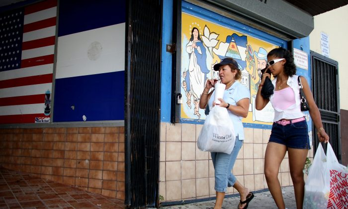 In a file photo, pedestrians walk past a store in the Little Havana neighborhood of Miami. Hispanics are the biggest segment of minorities in the United States and a prime marketing target. (Joe Raedle/Getty Images)
