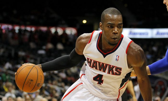 Atlanta Hawks forward Paul Millsap (4) drives to the basket in an NBA basketball game against the Detroit Pistons in Atlanta, Tuesday, April 8, 2014. (AP Photo/Todd Kirkland)
