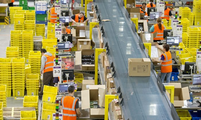 Employees work in a distribution center of Amazon in Leipzig, central Germany, March 26. (AP Photo/Jens Meyer)