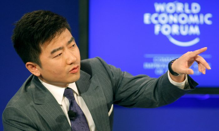 Director and anchor for China Central Television, Rui Chenggang moderates a session at the World Economic Forum in Davos, Switzerland on Jan. 29, 2011. (AP Photo/Michel Euler)