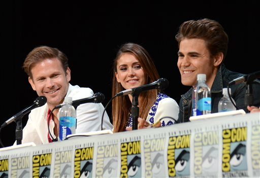 "Matthew Davis, from left, Nina Dobrev and Paul Wesley attend the ""Vampire Diaries"" panel on Day 3 of Comic-Con International on Saturday, July 26, 2014, in San Diego. (Photo by Tonya Wise/Invision/AP)"