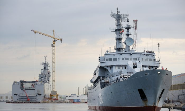 After going ahead with the sale of two Mistral helicopter-carrying ships to Moscow, France has to question its economic interests against violations of international law by Russia. (Jean-Sebastien Evrard/AFP/Getty Images)