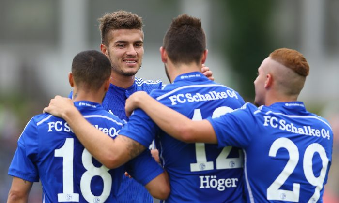 MArco Hoger (3rd L) celebrates the second goal with Sidney Sam (L), Roman Neustaedter (2nd L) and Donis Avdijaj (R) of Schalke during the friendly match between TuS Hordel and FC Schalke 04 at Lohrheidestadion on July 5, 2014 in Bochum, Germany. (Photo by Christof Koepsel/Bongarts/Getty Images)