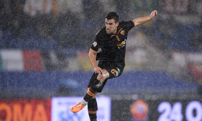 AS Roma's Dutch forward Kevin Strootman shoots and scores against Napoli during their semi-final Coppa Italia football match, on February 5, 2014 at Rome's Olympic stadium. (ANDREAS SOLARO/AFP/Getty Images)