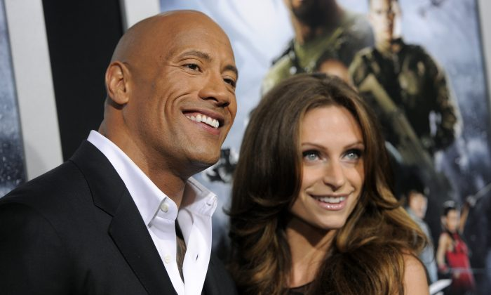 """Dwayne Johnson, a cast member in """"G.I. Joe: Retaliation,"""" poses with his girlfriend Lauren Hashian at the Los Angeles premiere of the film at the TCL Chinese Theatre on Thursday, March 28, 2013 in Los Angeles. (Photo by Chris Pizzello/Invision/AP)"""