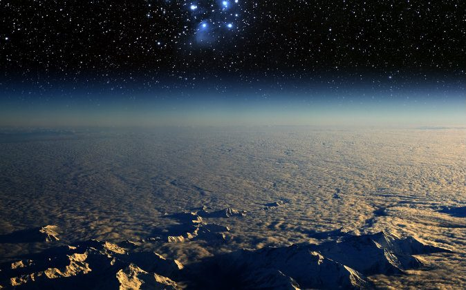 A high-altitude view of the Earth in space and the Pleiades star cluster. (Shutterstock*)