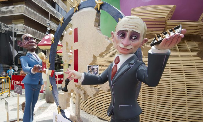 Hogueras, satirical structures made of cardboard portraying current events and personalities, of Russian Prime Minister Vladimir Putin (R) and U.S. President Barack Obama in Alicante, Spain, on June 23, 2014. (Jose Jordan/AFP/Getty Images)
