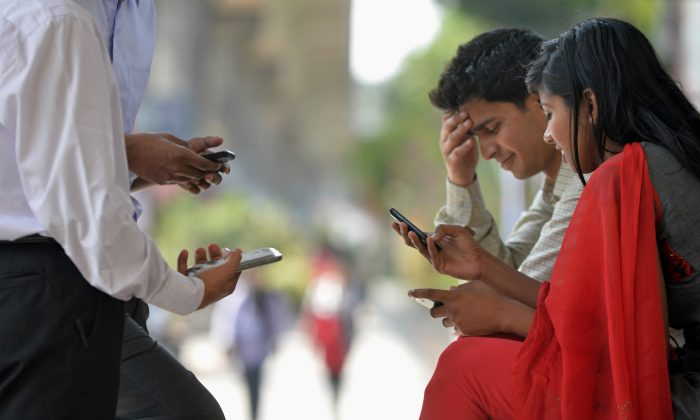 According to a study of almost 3,000 urban Bangalore residents, about four percent are addicted to their cellphones. India opened the nation's first treatment center for technology addiction in Bangalore in April to help the first generation of technology addicts.Photo taken January 30. (Manjunath Kiran/AFP/Getty Images)