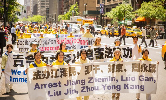 Over 8,000 Falun Dafa practitioners march in a parade for World Falun Dafa day, in Manhattan, on May 14, 2014. From 2002-2012 Zhou Yongkang has the principal responsibility for the persecution of Falun Gong practitioners. (Edward Dai/Epoch Times)