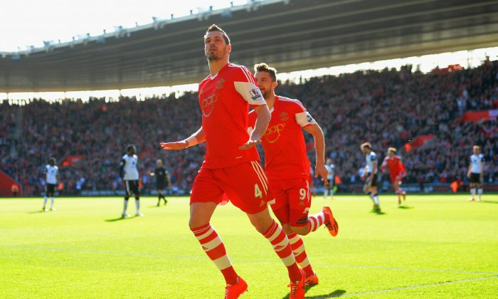 Morgan Schneiderlin of Southampton celebrates scoring the opening goal with Jay Rodriguez of Southampton during the Barclays Premier League match between Southampton and Norwich City at St Mary's Stadium on March 15, 2014 in Southampton, England. (Photo by Christopher Lee/Getty Images)