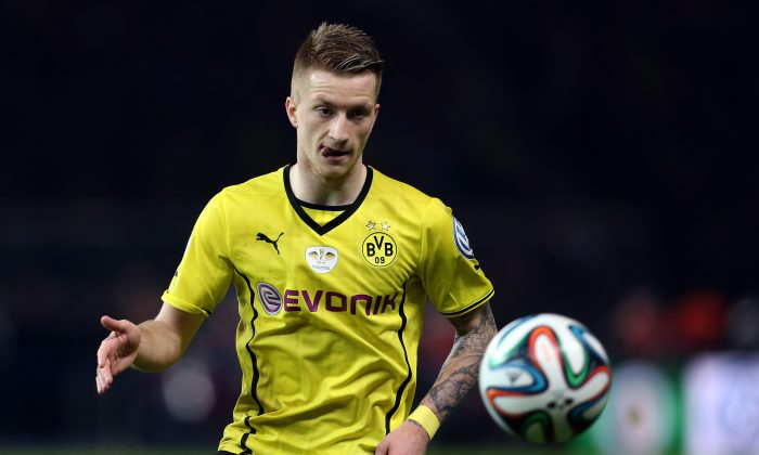 Marco Reus of Dortmund focusses the ball during the DFB Cup final match 2014 between Borussia Dortmund and Bayern Muenchen at Olympiastadion on May 17, 2014 in Berlin, Germany. (Photo by Ronny Hartmann/Bongarts/Getty Images)