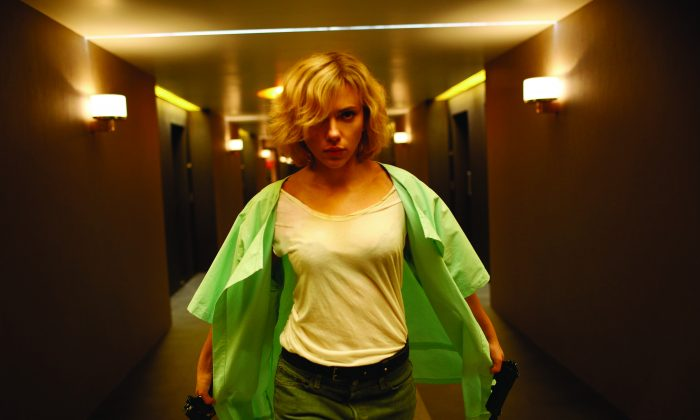 """Lucy (Scarlett Johansson) exacts revenge on her captors in """"Lucy."""" (Jessica Forde/Universal Pictures)"""
