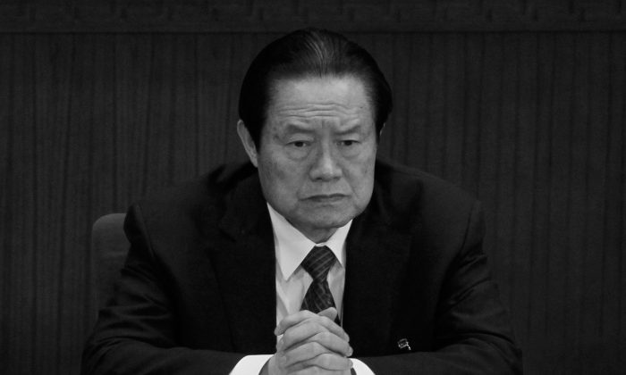 China's then-domestic security tsar Zhou Yongkang attends the National People's Congress on March 9, 2012, in Beijing. (AP Photo/Ng Han Guan)