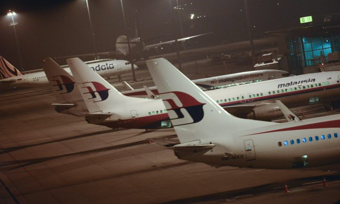 Malaysia Airlines planes are parked at Kuala Lumpur International Airport in Sepang, Malaysia, Thursday, July 18, 2013. A Malaysia Airlines flight with nearly 300 people aboard crashed over eastern Ukraine near the Russian border on Thursday, the Ukraine government and a regional European aviation official reported, Thursday, and the Interfax news agency said it had been shot down. (AP Photo/Joshua Paul)