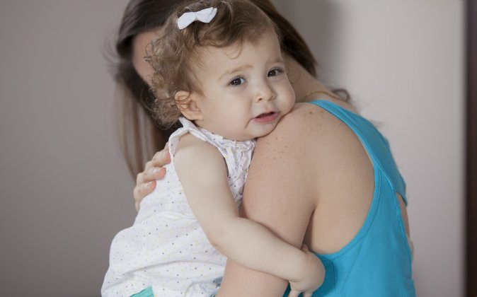 Stock photo of a mother holding her child. (Shutterstock)