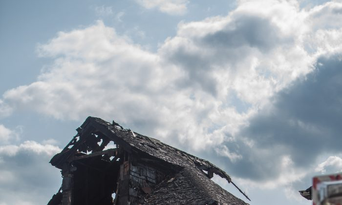 House at 4519 Hill Ave. damaged by fire in the Bronx, New York, on July 30, 2014. (Peter Svab/Epoch Times)