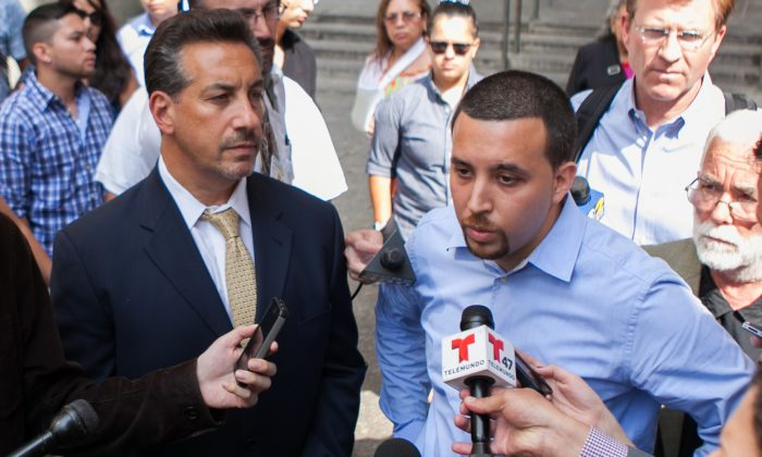 Alan Russo stands with his lawyer (L) as he talks to media about the trail of Franklin Reyes, 17, who killed his daughter Ariel, last year in a SUV while fleeing police, in Manhattan on July 30, 2014.  (Benjamin Chasteen/Epoch Times)