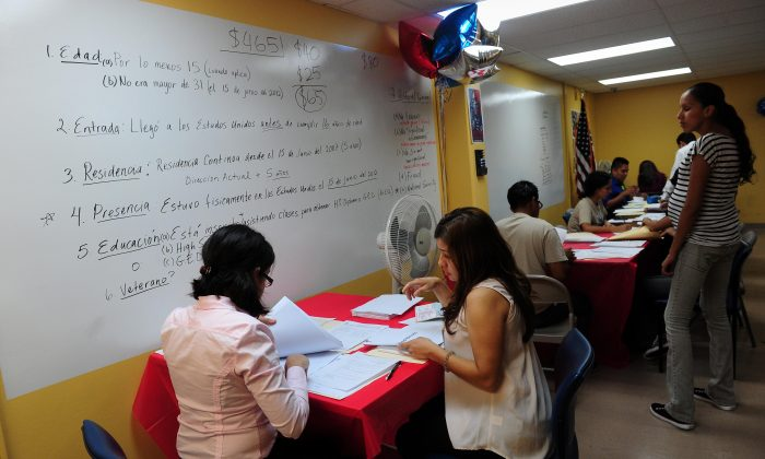 Young people receive assistance filling out forms at the office of the Coalition for Humane Immigrant Rights of Los Angeles (CHIRLA) on Aug. 15, 2012, the first day of the Deferred Action for Childhood Arrivals (DACA) program. (Frederic J. Brown/AFP/GettyImages)