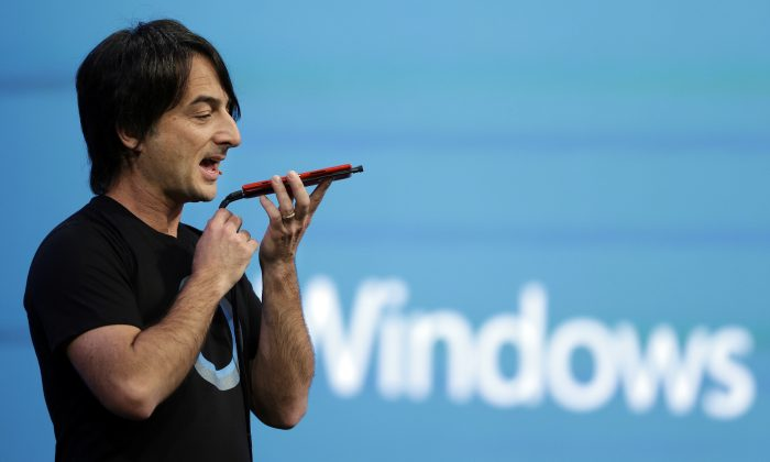 In this April 2, 2014 file photo, Microsoft corporate vice president Joe Belfiore, of the Operating Systems Group, demonstrates the new Cortana personal assistant during the keynote address of the Build Conference in San Francisco. (AP Photo/Eric Risberg)