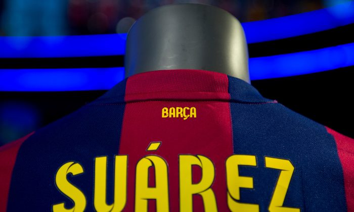 A shirt of new FC Barcelona player Luis Suarez are seen on display at the FC Barcelona official store on July 12, 2014 in Barcelona, Spain. (Photo by David Ramos/Getty Images)