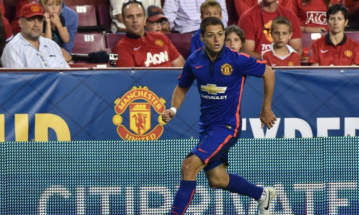 Manchester United's Javier 'Chicharito' Hernandez moves the ball against Inter Milan during a Champions Cup match against Inter Milan at FedEx Field in Landover, Maryland, on July 29, 2014. (NICHOLAS KAMM/AFP/Getty Images)